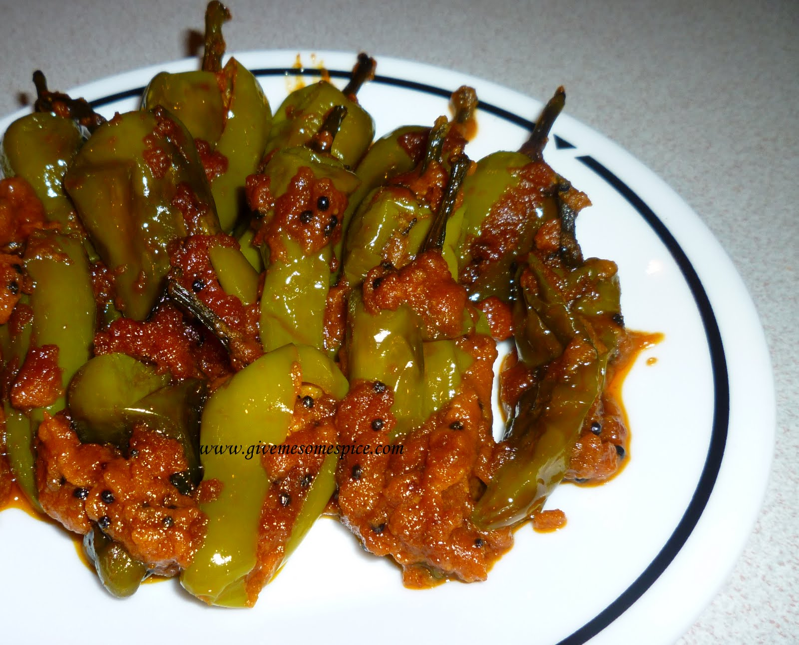 Stuffed hot green bullet chillies or bharela marcha authentic stuffed hot green bullet chillies or bharela marcha authentic vegetarian recipes traditional indian food step by step recipes give me some spice forumfinder Images